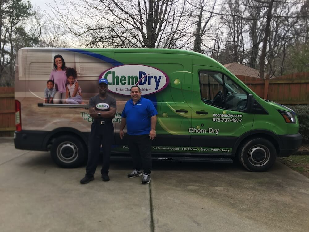 K&C Chem-Dry techs standing in front of green cleaning van in Atlanta