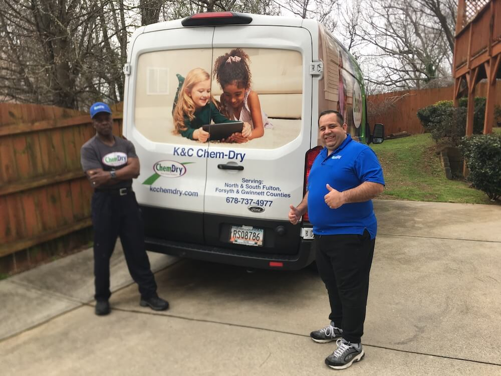 K&C Chem-Dry team in front of white cleaning van in Atlanta
