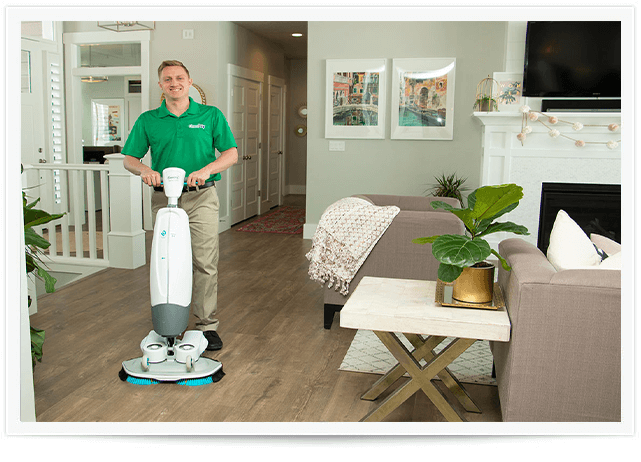 chem-dry tech performing a wood floor cleaning in alpharetta ga