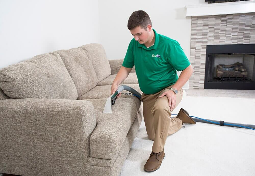 chem-dry tech performing upholstery cleaning in forsyth county ga
